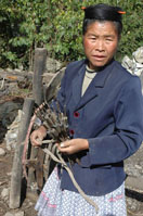 A Miao woman carrying tools